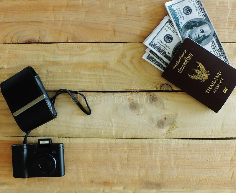 Compact cameras on desk. Travelers prepare before traveling abroad. Prepare passports, banknotes, compact cameras stock photo