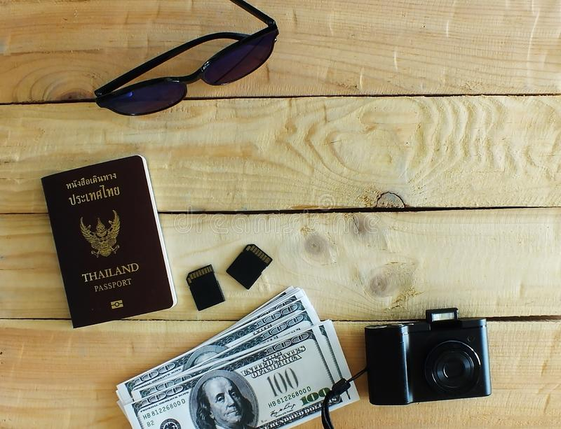 The wrist watches, compact cameras,two memory cards. Travelers prepare before traveling abroad. Prepare passports, banknotes, wrist watches, compact cameras,two stock photography