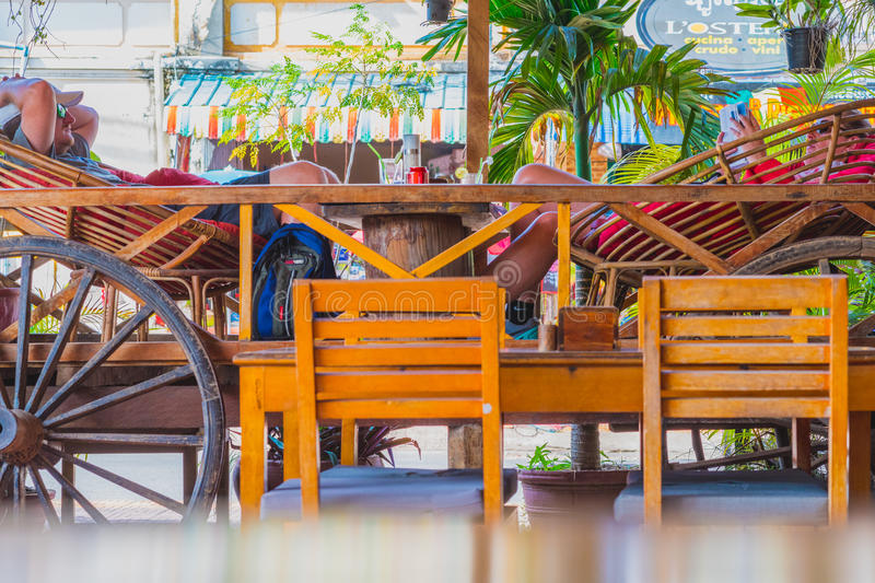 Travelers relax in a restaurant in Kampot stock photography