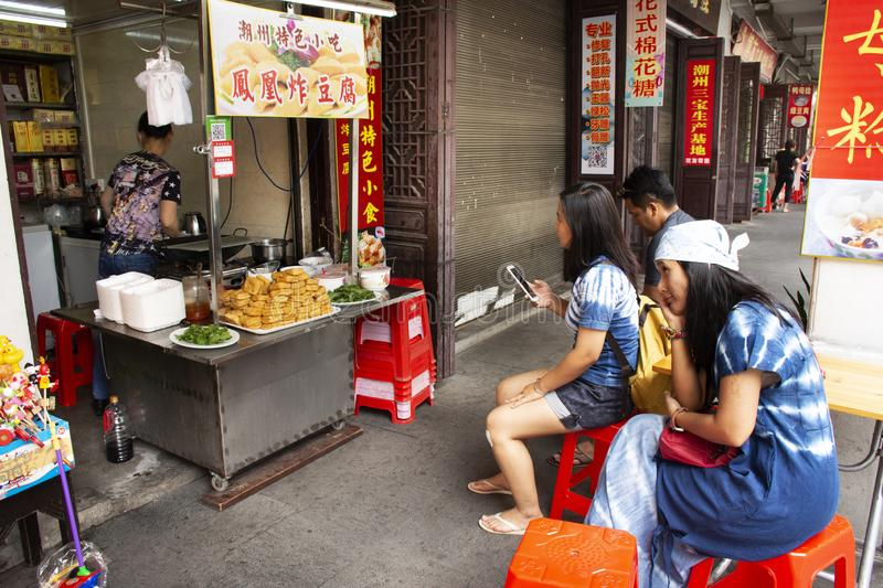 Travelers thai people waiting Chinese people cooking order Fried Tofu with vegetables and sweet sauce at restaurant in Chaozhou. Or Teochew on May 8, 2018 in stock photo