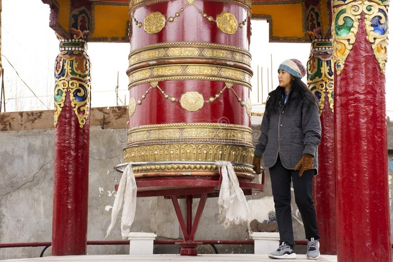 Thai women visit and praying and rite rotate and spin Prayer wheels in village at Leh Ladakh Valley in Jammu and Kashmir, India. Travelers thai woman people royalty free stock photos