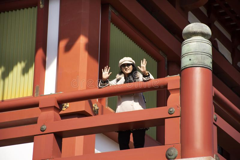 Travelers thai women travel and portrait posing for take photo at balcony on top of Daitou or Great pagoda of Naritasan Shinshoji royalty free stock images