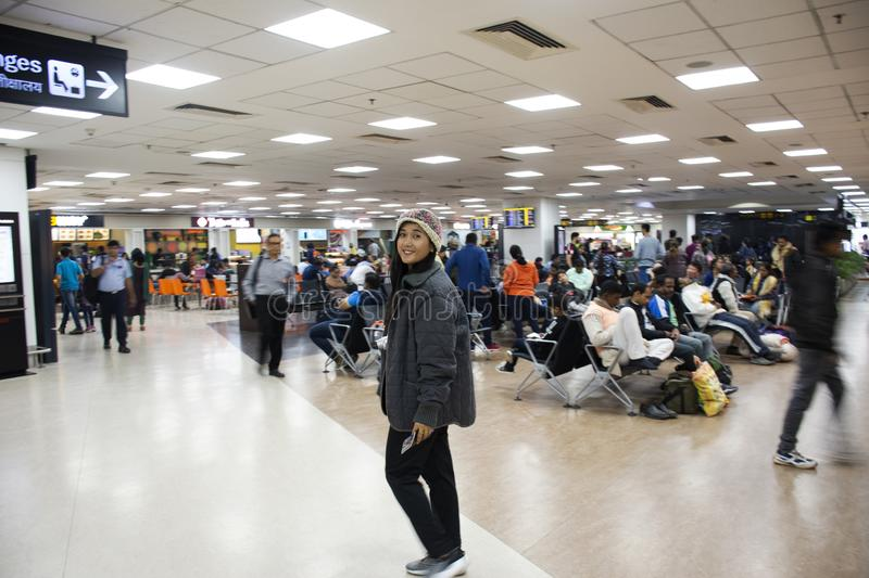 Travelers thai women and Indian and foreign walk and waiting check in inside of Indira Gandhi International Airport at terminal 2 stock photo