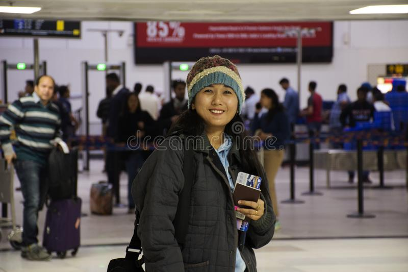 Travelers thai women and Indian and foreign walk and waiting check in inside of Indira Gandhi International Airport at terminal 2 stock photos