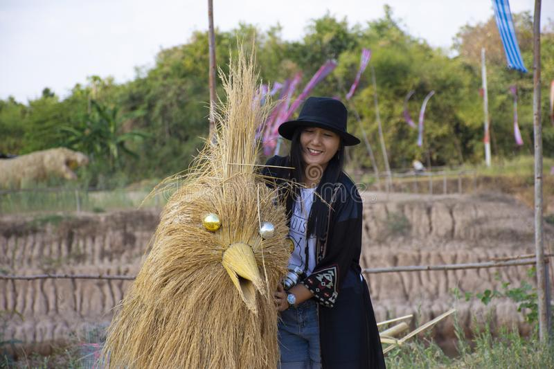 Travelers thai women people travel visit and posing portrait for take photo straw puppets or straws man figure Festiva. Travelers thai woman people travel visit royalty free stock image