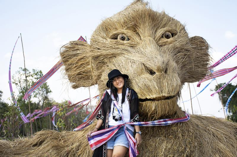 Travelers thai women people travel visit and posing portrait for take photo straw puppets or straws man figure Festiva. Travelers thai woman people travel visit royalty free stock photography