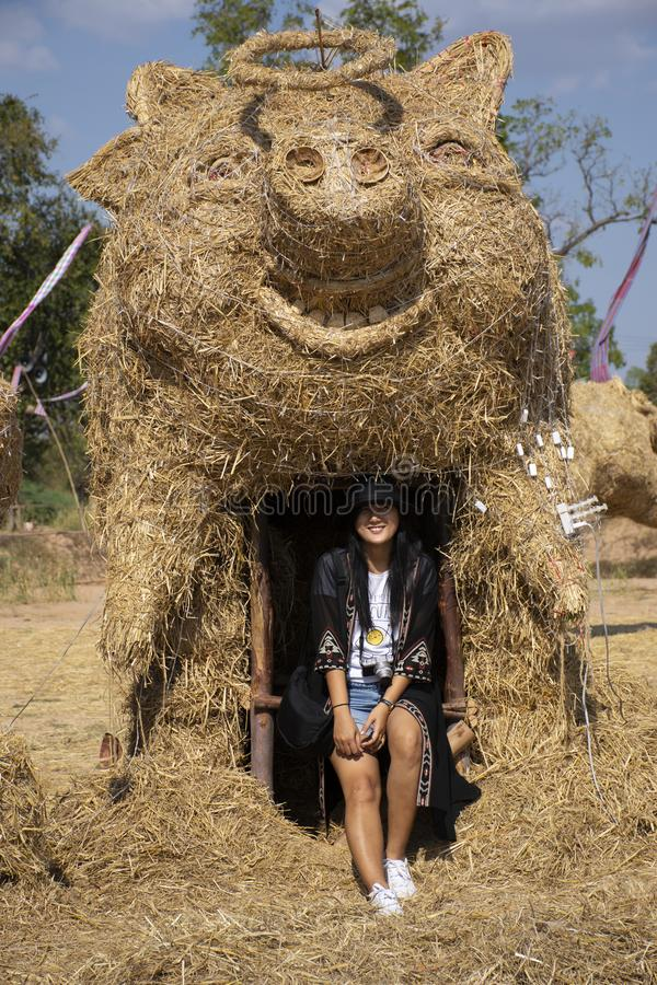 Travelers thai women people travel visit and posing portrait for take photo straw puppets or straws man figure Festiva. Travelers thai woman people travel visit stock image
