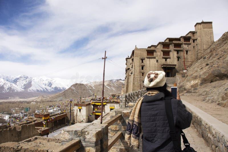 Thai women travel visit and take photo view landscape of Leh Ladakh Village at Leh Stok Palace at Jammu and Kashmir, India royalty free stock images