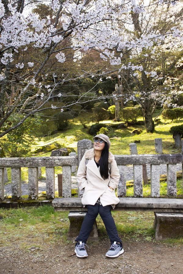 Travelers thai women posing portrait with Sakura tree in Naritasan plum garden of Narita public park at Chiba in Tokyo, Japan stock photography