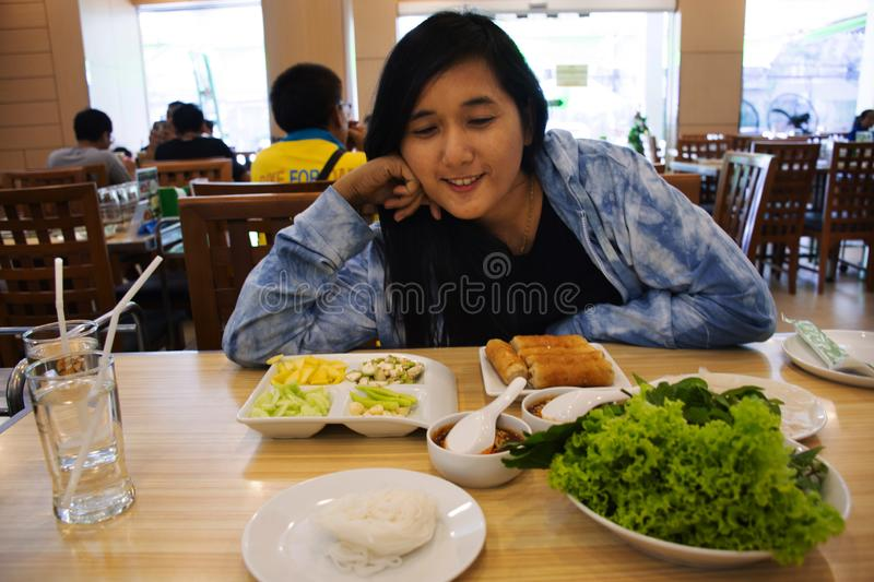 Travelers thai women posing for take photo with food set breakfast thai style server with cold tea drinks before eating. Travelers thai woman posing with stock images
