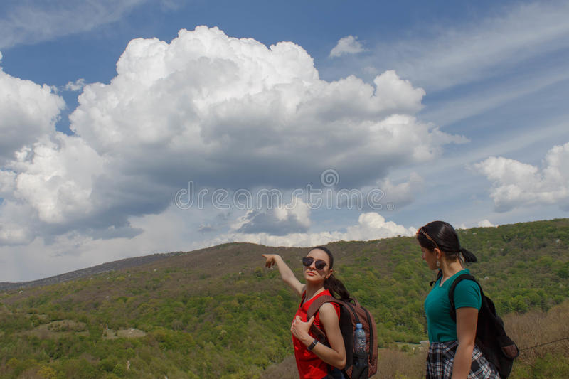 Travelers travel In the forest of the mountains reserve. Active and healthy lifestyle on summer vacation and weekend tour stock images