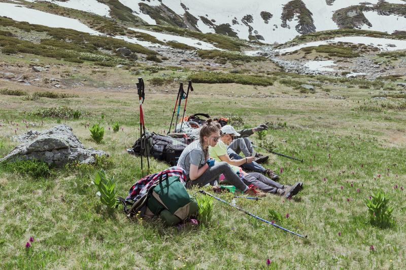 Travelers in the mountains resting on the camping. royalty free stock photography