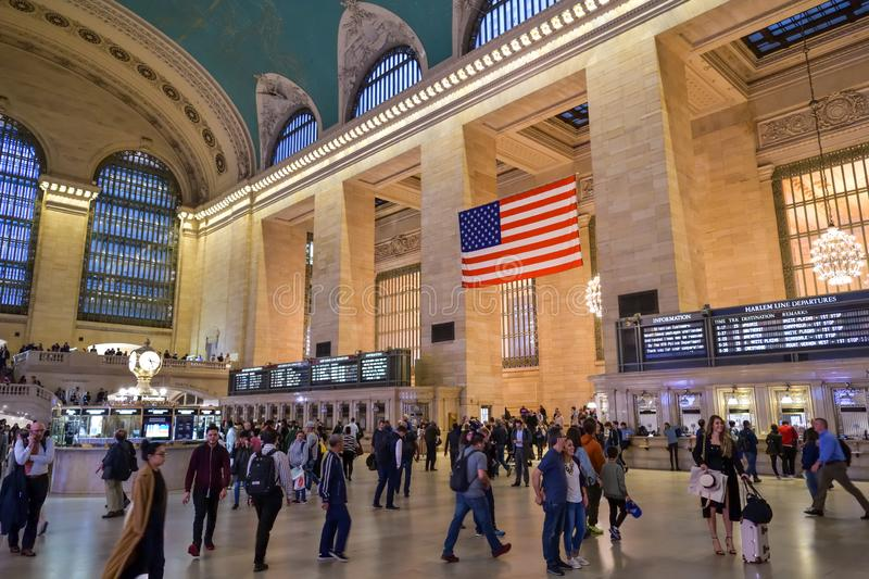 Travelers walking through Main Concourse in Grand Central Terminal in New York City royalty free stock photo