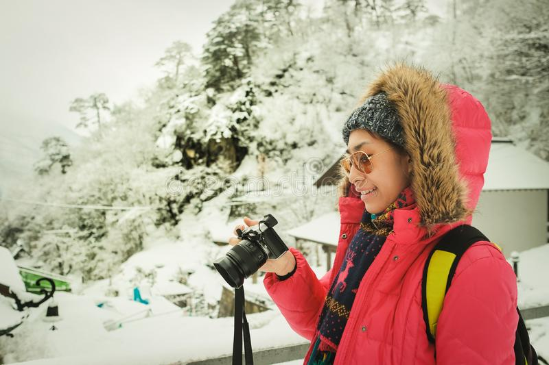 Travelers are watching photos taken with digital cameras during winter travel at yamadera hakata. In japan royalty free stock photography