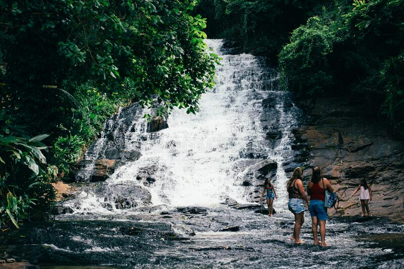 Travelers at waterfall royalty free stock images