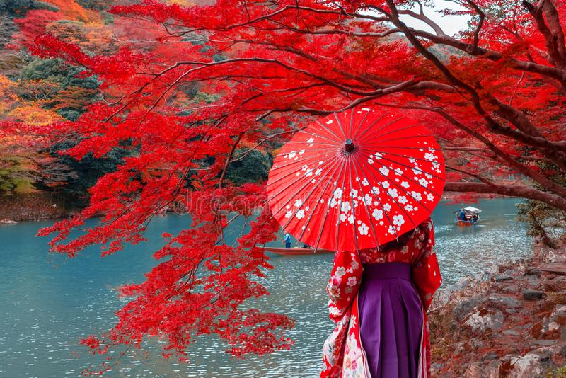 Travelers wear a kimono to see the beauty of autumn. royalty free stock photo