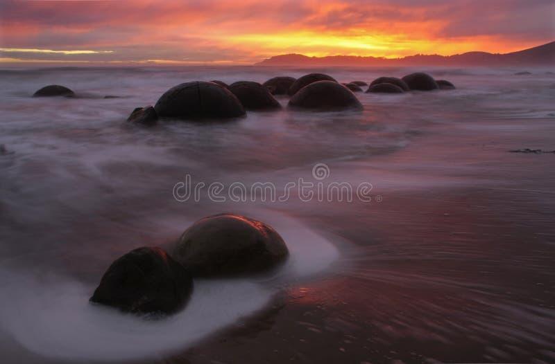 Travel-Images-Moeraki-Boulders. Moeraki boulders, Otago, New Zealand at sunrise stock photos
