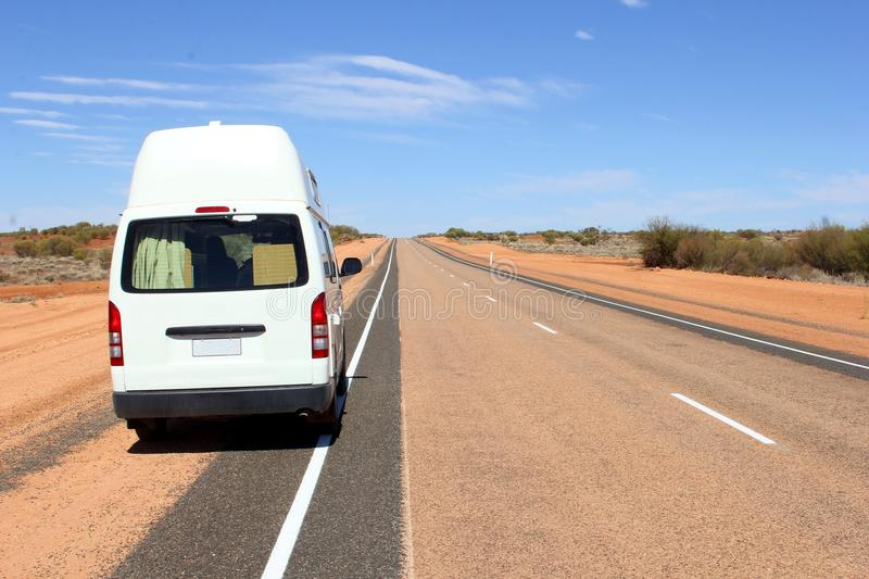 Traveling camper van desert outback, Australia. Hitop camper van at the national Lasseter Highway which connects Yulara, Uluru Ayers Rock and Kata Tjuta ( royalty free stock photos