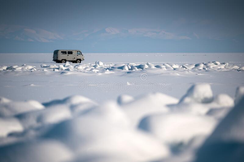 Traveling by car in Lake Baikal. This trip is popular for the winter time of Lake Baikal royalty free stock images