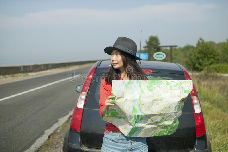 Traveling by car with a map on the road royalty free stock images