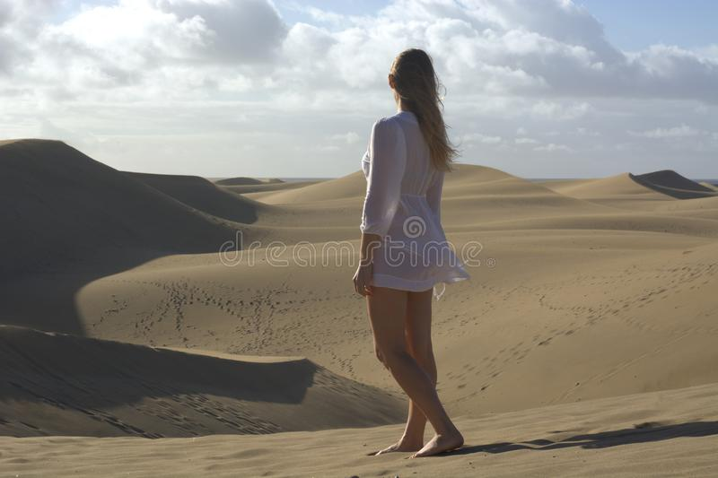 the woman observes the desert dunes royalty free stock photo