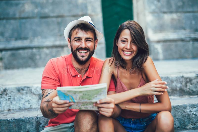 Traveling couple of tourists walking around old town. stock images