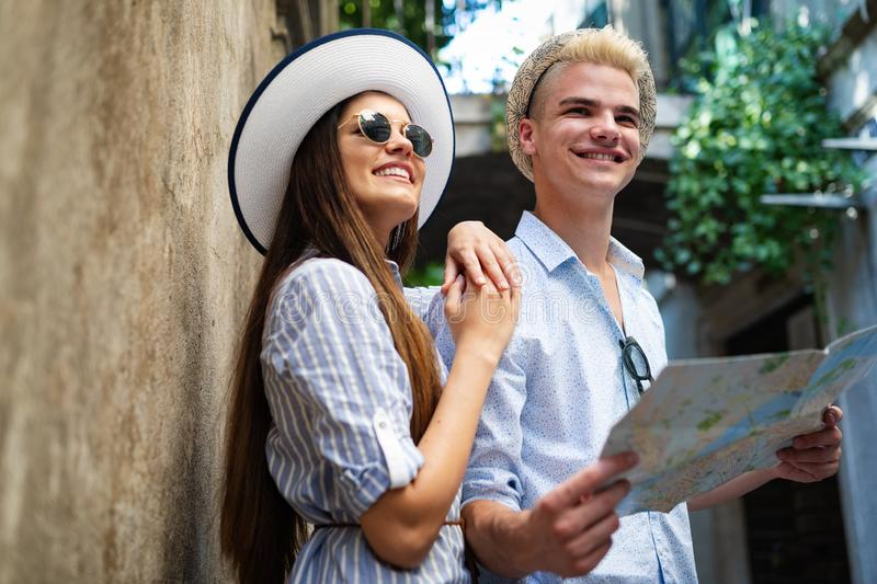Traveling couple tourists walking around old town. Vacation, summer, holiday, tourism concept stock photos
