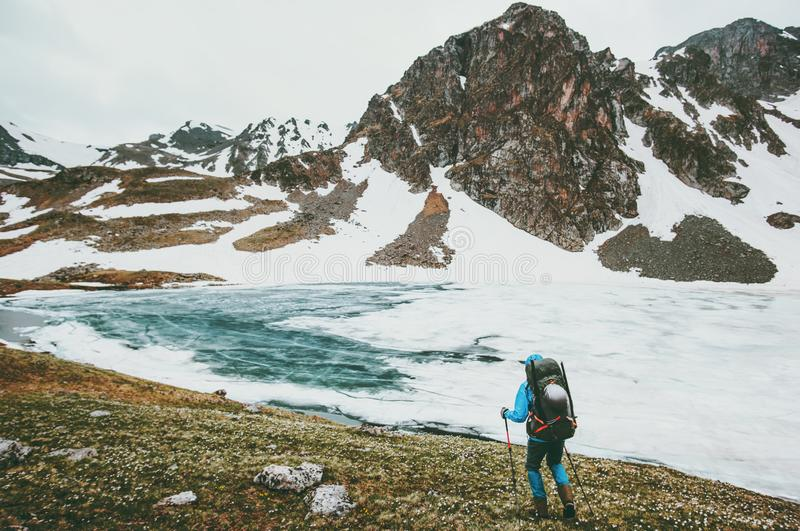 Traveling hiker man with backpack hiking in mountains stock photos