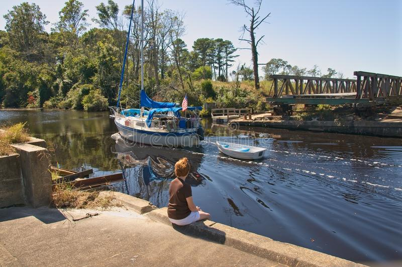 Traveling The Intercoastal Waterway. Dismal Swamp portion of the Intercostal Waterway.This is the oldest continually operating man-made canal in the United stock photo