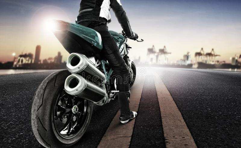 Download Traveling Man Riding Big Motorcycle On Urban Road Stock Photo - Image of motor, extreme: 108884046
