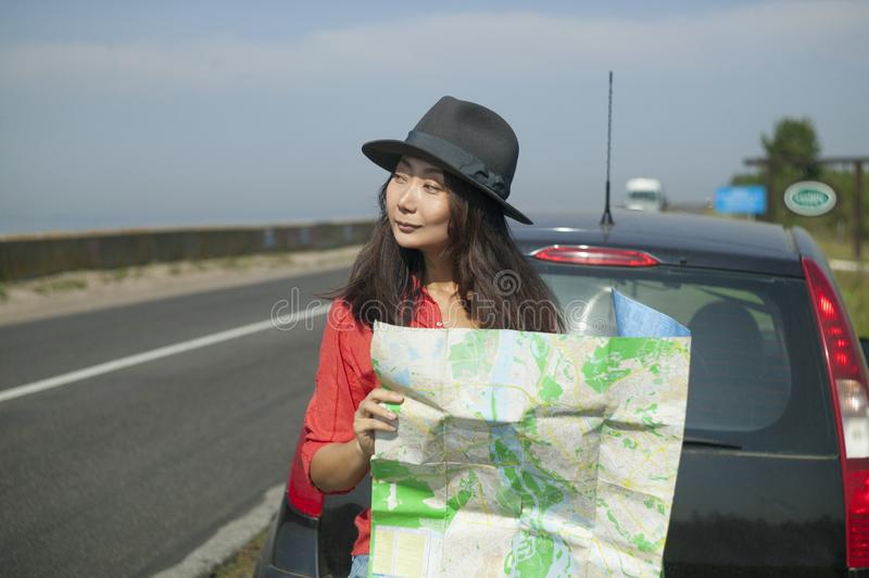 Traveling with a map on the road stock photo