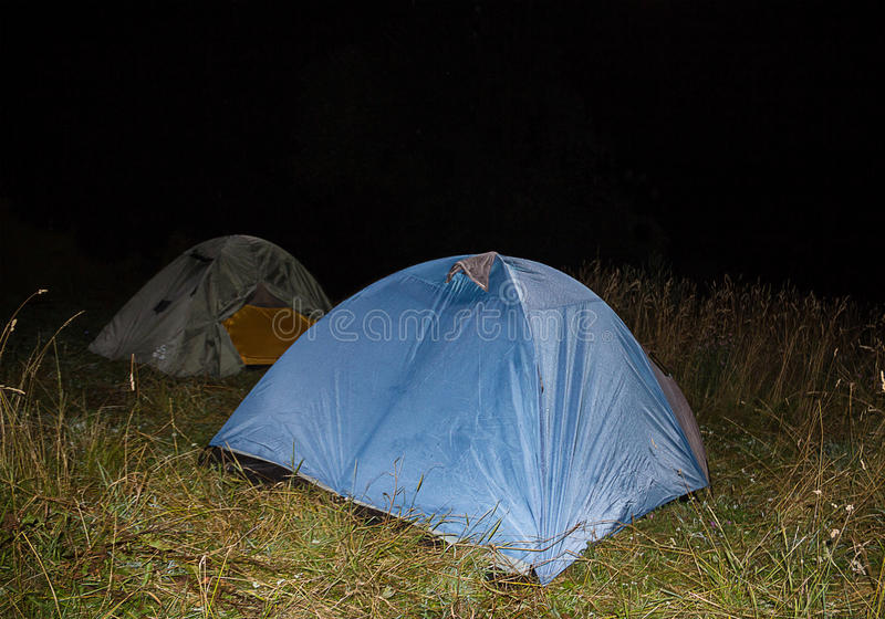 Traveling in the meadow set camp in the open air night royalty free stock images