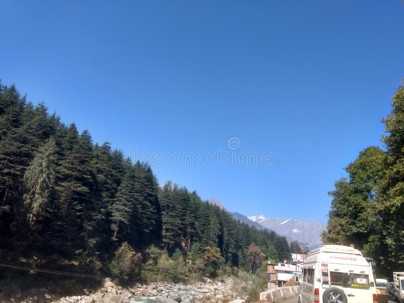 Traveling near beautiful river with trees stock photography