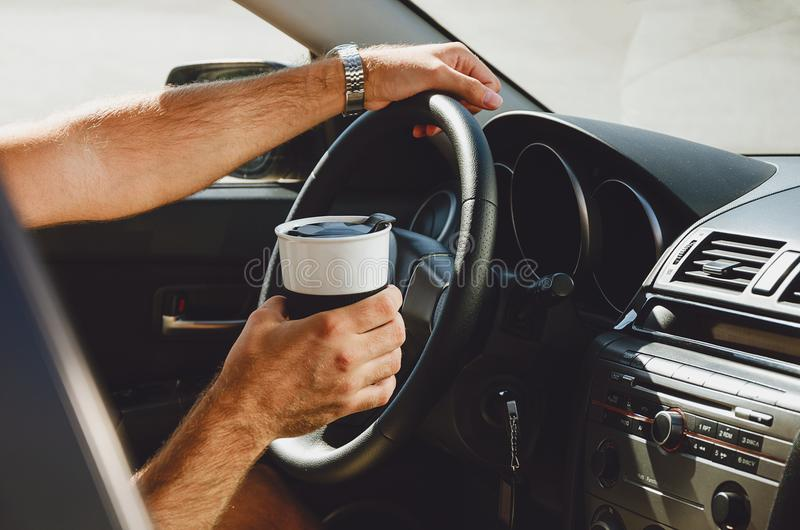 Traveling on the road, drinks and people in the car with cups of coffee royalty free stock photography