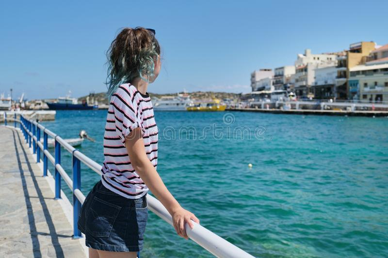 Traveling teenager girl on sea bay Mirabello enjoys beauty nature stock photography