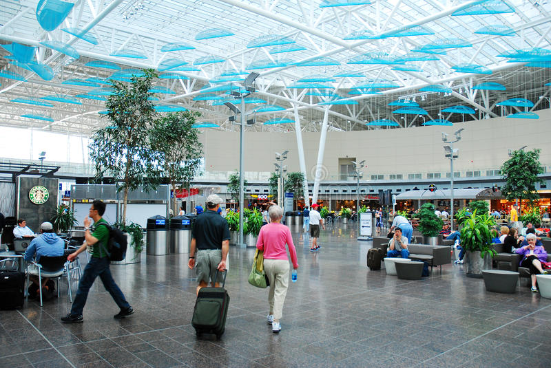 Traveling through. Travelers walk through the main lobby of the Indianapolis International Airport stock photography