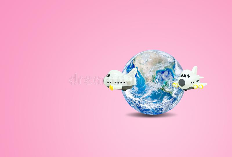 Traveling and Vacation Concept : Airplane flying around blue planet earth globe with pink background. royalty free illustration