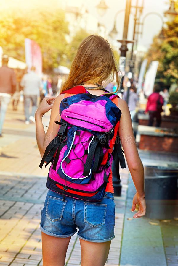 Traveller girls with back view close up violet female backpack royalty free stock photography