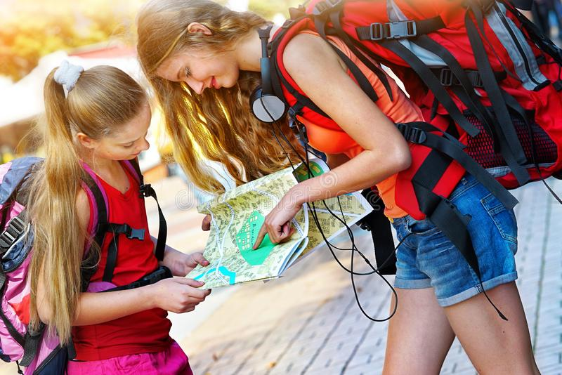 Traveller girls with backpack looking for way tourist paper map royalty free stock images