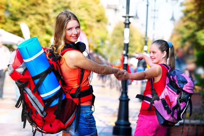 Traveller girls with backpack wallking on European cultural city stock photo
