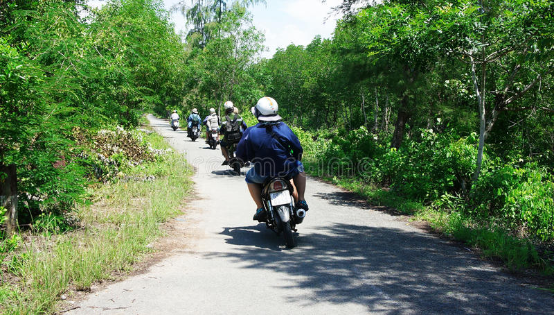 Download Traveller Make A Tour By Motobike. CA MAU, VIET NAM- JUNE 29 Editorial Image - Image of asian, take: 33962700