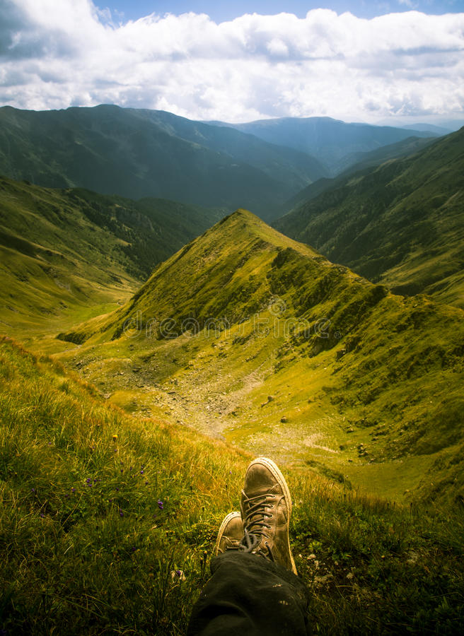 A traveller resting in a mountain landscape in Carpathian mountains royalty free stock photography