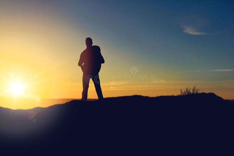 Traveller standing on edge of hill over sunrise. Travel, tourism, hike and people concept - traveller with backpack standing on edge of hill over sunrise vector illustration