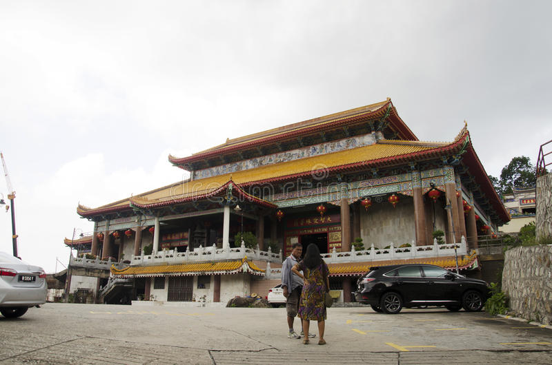 Traveller thai woman asking malaysian people at front of Kek Lok Si Chinese and Buddhist temple. In Georgetown on April 26, 2016 in Penang, Malaysia stock photo