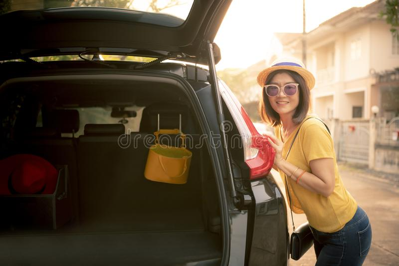 Traveller woman toothy smiling face happiness emotion standing on back of suv car ready for road trip on vacation time stock photos