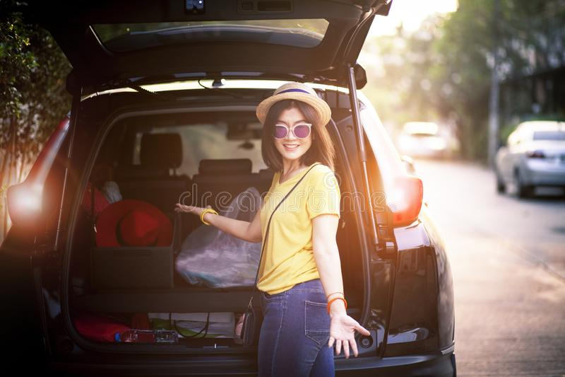 Traveller woman toothy smiling face happiness emotion standing on back of suv car ready for road trip on vacation time royalty free stock image