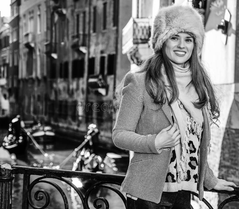 Traveller woman in Venice, Italy looking into the distance. Venice. Off the Beaten Path. happy trendy traveller woman in fur hat in Venice, Italy in the winter royalty free stock images