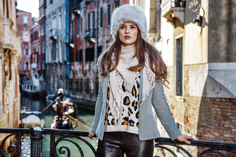 Traveller woman in Venice, Italy looking into the distance. Venice. Off the Beaten Path. trendy traveller woman in fur hat in Venice, Italy in the winter looking royalty free stock photo