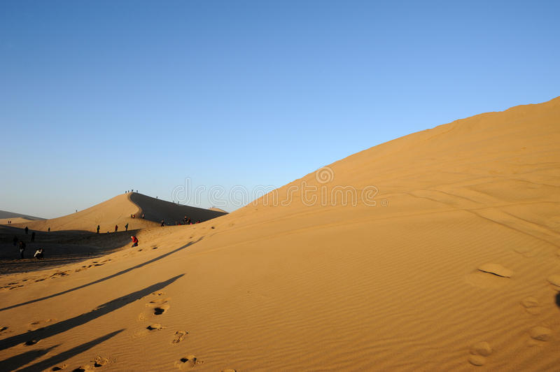 Travellers in the desert. Located in Inner Mongolia Ejinaqi, China stock photo