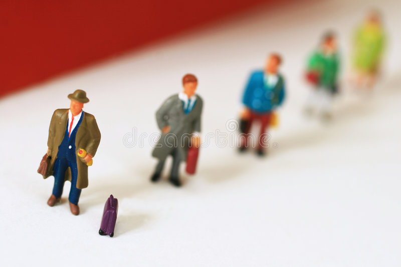 Travellers in queue. Travellers waiting in queue for transportation royalty free stock photo